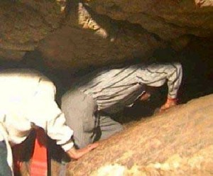 People crawling in the shiv Khori cave